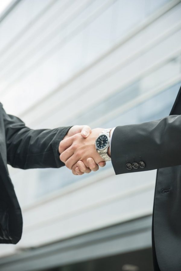 close-up-male-female-shaking-hands-business-deal_23-2148026595